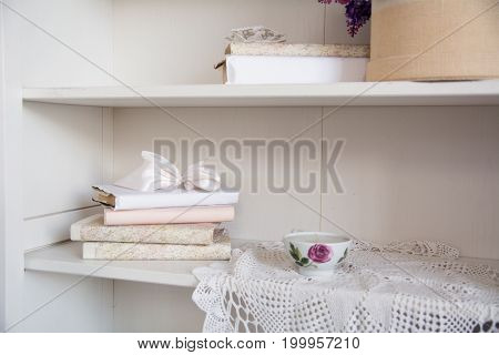 Rack With Old Books And A Porcelain Cup