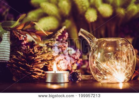 Sparklers In Glass Jar At Night With  Blurred Light Candle Burning.