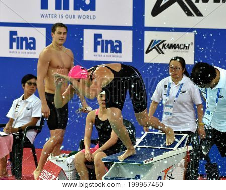 Hong Kong China - Oct 30 2016. World champion swimmer Yulia YEFIMOVA (RUS) at the start of the Mixed Freestyle 4x50m Final. MOROZOV Vladimir (RUS) in the background. FINA Swimming World Cup.