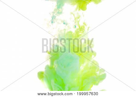 Yellow, blue, and green acrylic colors. Ink swirling in water. Color explosion