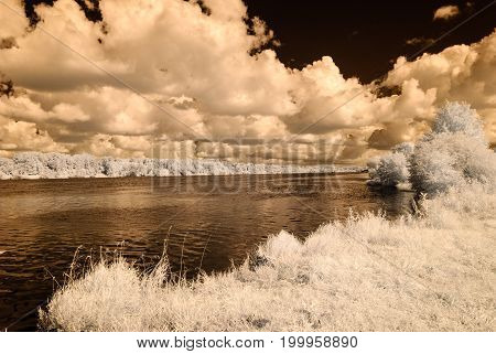 Sea Beach With Dramatic Clouds. Infrared Image