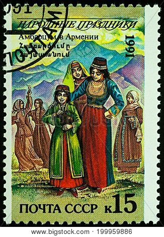 Moscow Russia - August 14 2017: A stamp printed in USSR shows Ambartsum (Ascension Day) in Armenia women in traditional costumes series