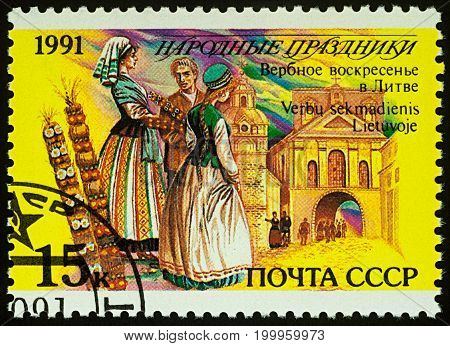 Moscow Russia - August 14 2017: A stamp printed in USSR shows Palm Sunday in Lithuania series