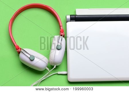 Headphones And Silver Laptop. Sound Recording Idea
