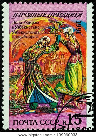 Moscow Russia - August 14 2017: A stamp printed in USSR shows Lola-bayram (tulip holiday) in Uzbekistan series