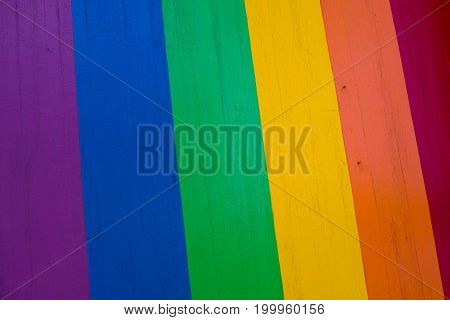 Background of grungy old wood planks in rainbow colors gay pride symbol
