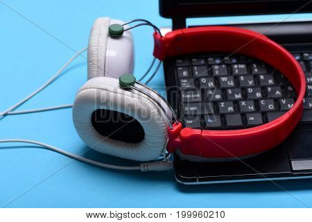 Headphones And Black Laptop. Sound Recording And Digital Equipment Concept