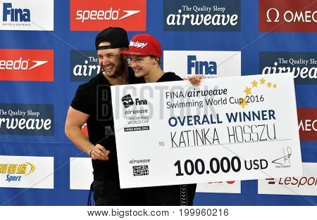 Hong Kong China - Oct 30 2016. Overall winner Katinka HOSSZU (HUN) with her coach and husband Shane TUSUP (USA) of the FINA Swimming World Cup in 2016.