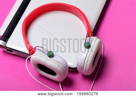 Earphones With Computer On Magenta Pink Background