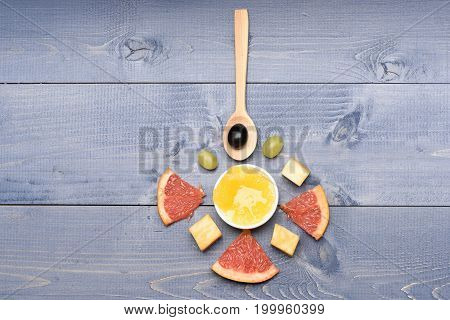 Composition Of Wooden Spoon, Marble Cheese, Honey And Grapefruit