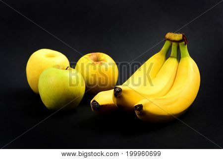 Apples And Bananas On Black Background