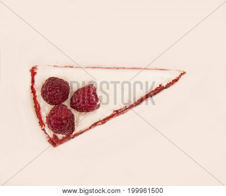 Top view of red pie with raspberries and white cream isolated over white