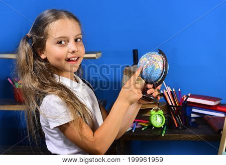 Girl Stands By Desk With Books. Kid And School Supplies