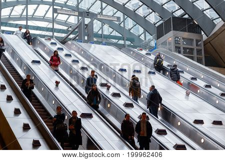 Entrance Of Canary Wharf Underground Station With Commuters On Escalators