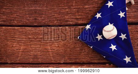 Close-up of baseball on an American flag
