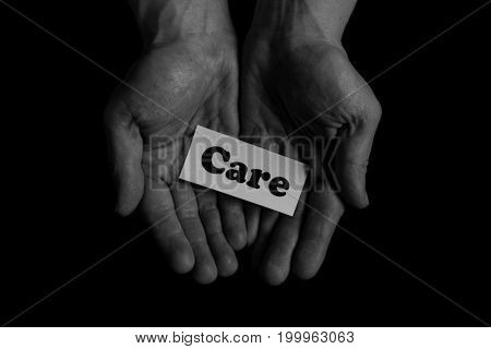 Offering Care, helping hands, care and support concept Black and white