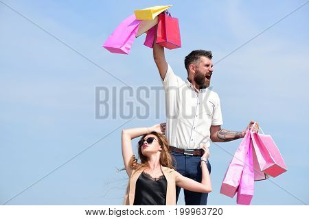 Shopping And Relationship Concept. Macho Carries Pink Packets