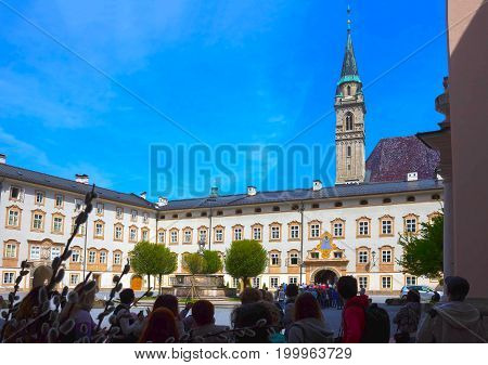 Salzburg, Austria - May 01, 2017: The people at excursion at the square of St. Peter, Salzburg, Austria on May 01, 2017. Salzburg is renowned for its baroque architecture. It is an Unesco World Heritage Site.