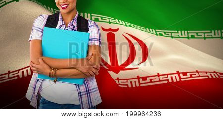 Casual young woman with folder in office against digitally generated iranian national flag