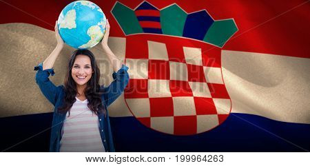 Happy woman with globe against digitally generated croatian national flag