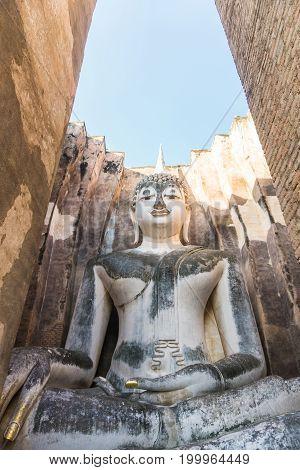 Phra achana buddha statue in wat si chum temple at sukhothai historical park thailand