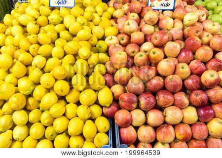 Apples and lemons for sale at a market in Valparaiso, Chile