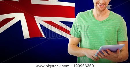 Student using tablet against digitally generated australian national flag