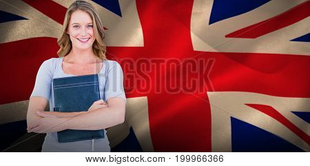 Happy student against digitally generated great britain national flag