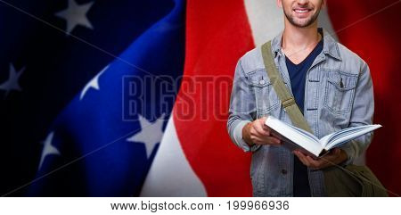 Student smiling at camera in library against crumbled american flag