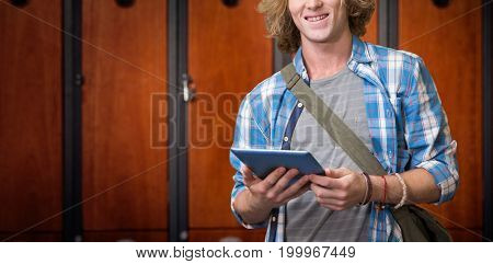 Student using tablet in library  against close-up of brown lockers