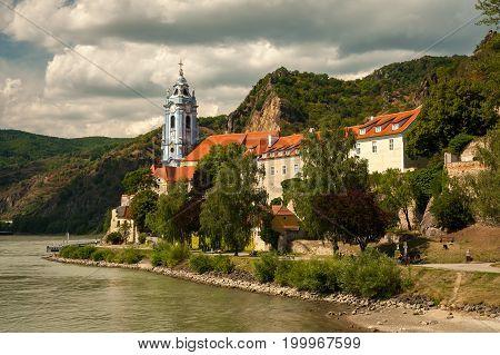 Dürnstein church near the river danube as seen from a boat