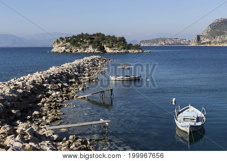 The view on a small island in the sea and fishing boats