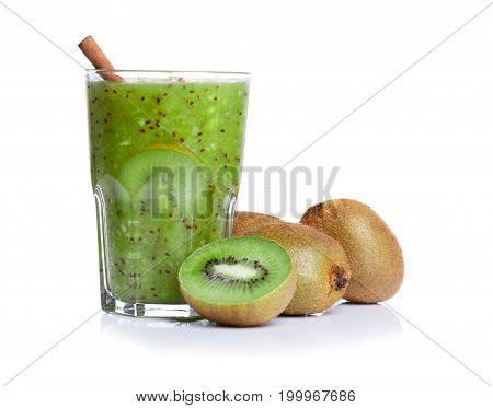 A fresh homemade kiwi smoothie with cinnamon stick full of nutritious vitamins, isolated on a white background. Whole and cut kiwis near a drink. Natural and healthy cocktail for vegan breakfast.