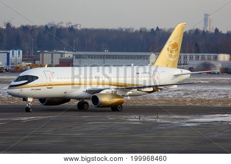 Sheremetyevo, Moscow Region, Russia - 23 March, 2014: Tsentr-Yug Sukhoi Superjet 100 RA-89004 in golden livery taxiing at Sheremetyevo international airport.