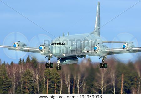 Kubinka, Moscow Region, Russia - February 19, 2014: Ilyushin Il-20M RF-93610 reconnaissance airplane landing at Kubinka air force base.
