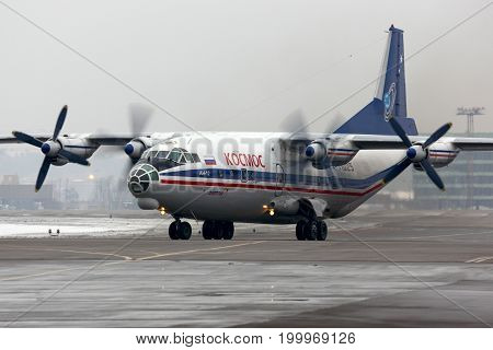 Sheremetyevo, Moscow Region, Russia - February 24, 2014: Kosmos Airlines Antonov An-12 RA-11025 at Sheremetyevo international airport.