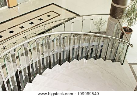 Part of spiral staircase. Interior in pale colors