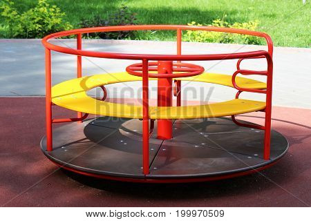 Modern Playground for children round a roundabouta quick swing