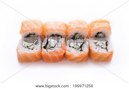 Traditional japanese food delivery. Philadelphia salmon set isolated at white background, closeup. Healthy asian restaurant meals