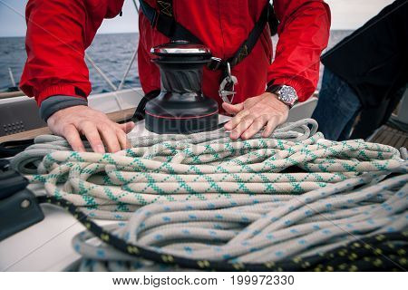 Hands sailor braid rigging ropes on the boat, right on the ship in the cruise