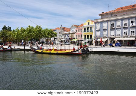 Aveiro Portugal - June 10 2017: Traditional boats moliceiro on main city canal. Aveiro known as Venice of Portugal