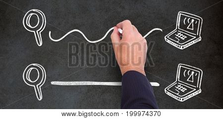 Hand of a businessman writing with a chalk against close-up of blackboard