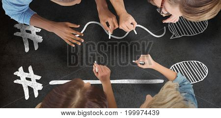 Business people writing with chalks against close-up of blackboard