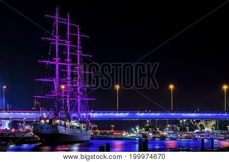 FRIGATE AT WHARF - Tall Ships Races. Great sailing ship MIR at night at the quay of the port of Szczecin
