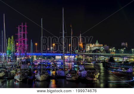 MARINA AT NIGHT - Yachts and sailing ship Mir moored at the wharf of the marina in Szczecin