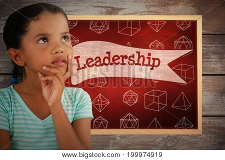 Close-up of thoughtful girl against leadership against desk