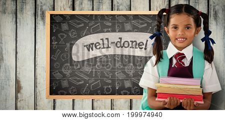 Smiling schoolgirl carrying books against well-done! against black background
