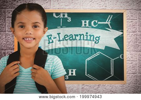 Portrait of smiling girl with bag against e-learning against green chalkboard