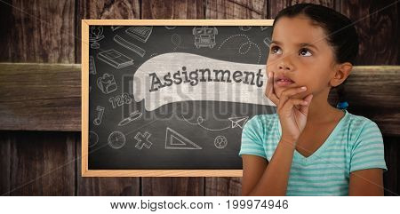 Close-up of thoughtful girl against assignment against black background