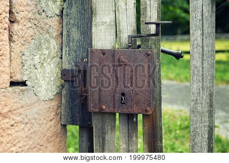 closeup of old wooden fence with door handle